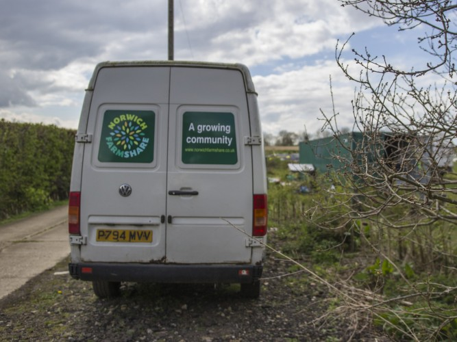 FarmShare - (wo)man in a van, with veg.